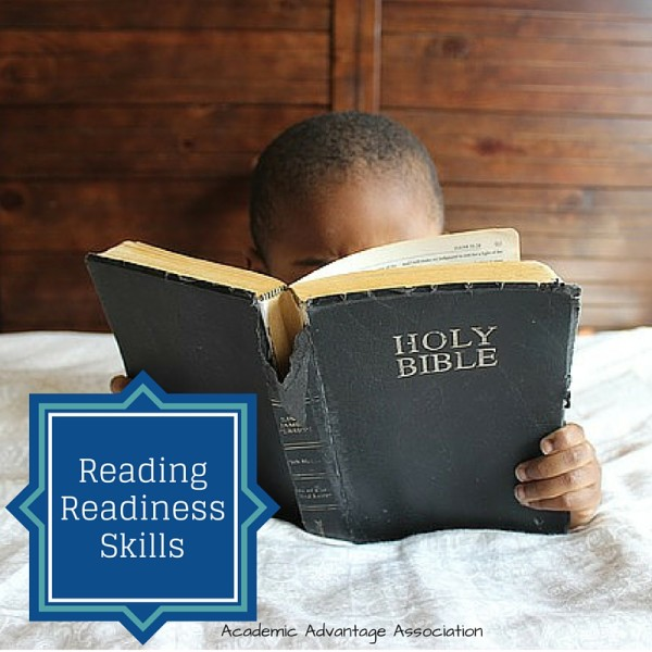 Child reading with reading readiness reading the Bible.
